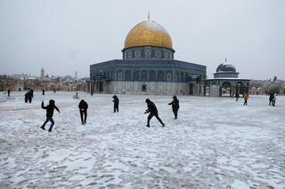 Children playing in the snow on the Temple Mount in Jerusalem