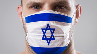 A man wearing a face mask bearing the Israeli flag