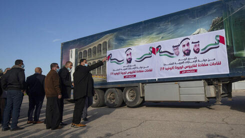 A truck loaded with Russian-made Sputnik V doses from the UAE arrives in the Gaza Strip via the Rafah crossing with Egypt, on February 21, 2021. Around 20,000 coronavirus vaccine doses from the UAE arrived in Gaza today, a delivery reportedly orchestrated by a rival of Palestinian president Mahmud Abbas three months before scheduled Palestinian elections.