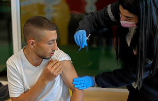 Health worker administers COVID-19 vaccine in Beit Shemesh