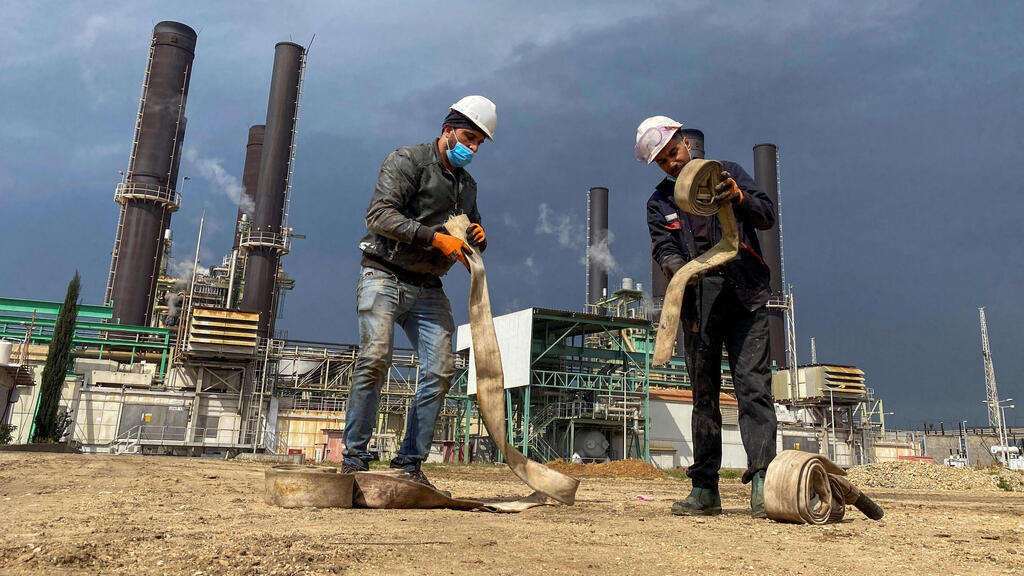 Workers are seen at Gaza's lone power plant, in the central Gaza Strip