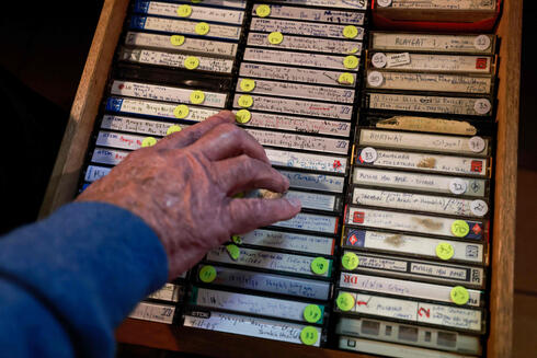 Bailey shows his collection of audio tape recordings of interviews with members of the Bedouin community at his home in Jerusalem