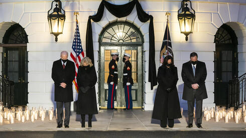 US President Joseph Biden (L), First Lady Jill Biden (C-L), Vice President Kamala Harris (C-R) and Second Gentleman Doug Emhoff (R) hold a moment of silence for the 500,000 Americans who have died from the Covid pandemic