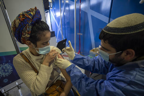 An Israeli woman is vaccinated against COVID-19 at a Jerusalem medical center, Feb. 23, 2021