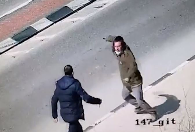 Binyamin Cohen fends off his knife-wielding attacker at the junction close to the West Bank settlement of Yitzhar, Feb. 24, 2021