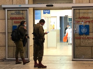 IDF officers at the entrance to Hadassah Medical Center, Ein Kerem after the wounded soldier was taken there on Tuesday night