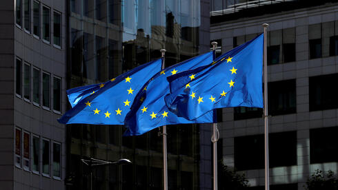 European Union flags flutter outside the European Commission headquarters in Brussels,