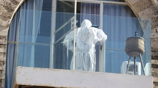 A police forensic team at the coronavirus hotel where the suspected rape took place