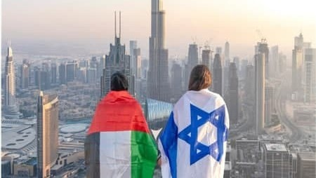 Women draped in the flags of the UAE and Israel and in Dubai