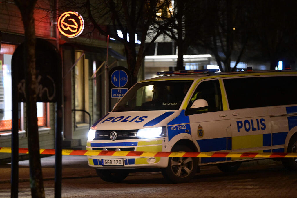 Police cordone off the scene of an attacked injuring eight people in the Swedish city of Vetlanda