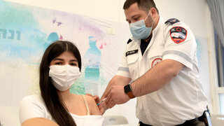 Teens in a school in Lod getting vaccinated against COVID