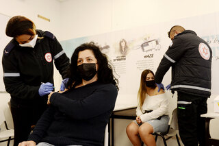 Young Israelis receive the coronavirus vaccination at the Ort School in Lod