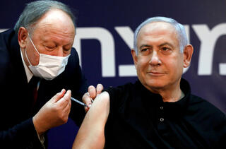 Prime Minister Minister Benjamin Netanyahu receives a coronavirus disease (COVID-19) vaccine at Sheba Medical Center in Ramat Gan