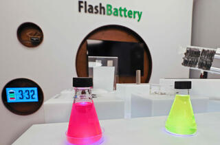 A display promoting fast-charging batteries is pictured at the entrance to StoreDot's Herzilya headquarters, Feb. 2021