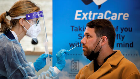 A health worker takes the antigen test, developed by Sheba Medical Center,