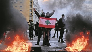 Lebanese protesters take to the streets of Beirut to demonstrate against the cost of living, March 2021