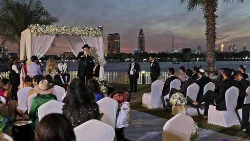 Rabbi officiates wedding under a canopy during marriage ceremony in Dubai