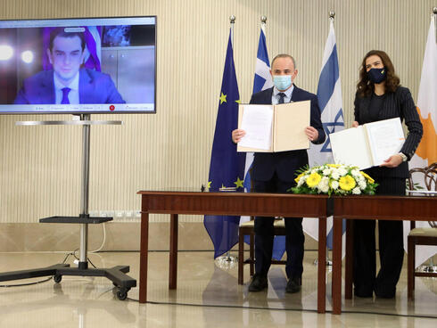 Yuval Steinitz with his Cypriot counterpart Natasa Pilides and Greek Energy Minister Kostas Skrekas on video call, after signing deal linking power grids