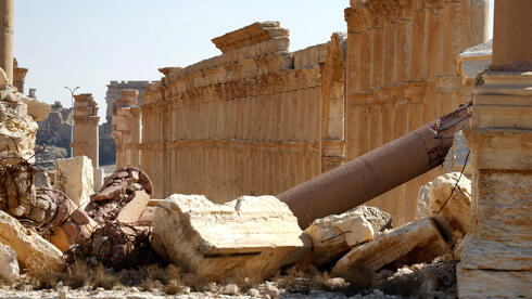 the Great Colonnade in the ruins of Syria's Roman-era ancient city of Palmyra