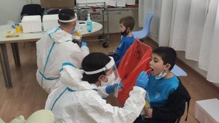 Young students undergo coronavirus testing in northern Israel