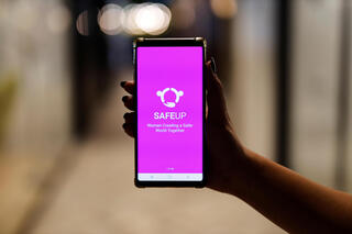 A woman presents the SafeUP, a women's safety net application, at a co-working space in Tel Aviv