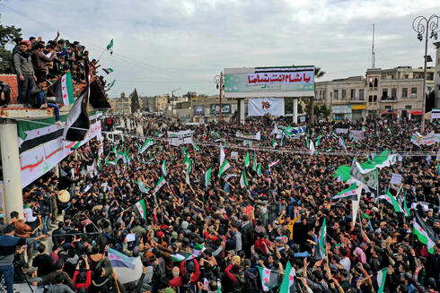 Members of opposition to Syrian President Bahar al-Assad in the city of Idlib to which Saudi Arabia has provided support