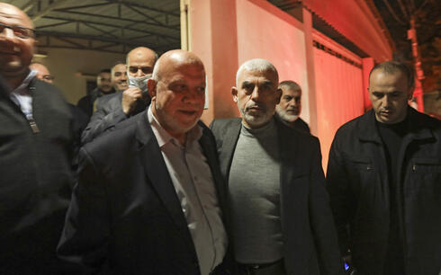 Nizar Awadallah (center left) with Yahya Sinwar  whom he challenged for the leadership of Hamas in the 2021 elections