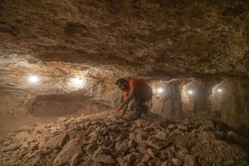 An Archeologist in the Horro cave in the Judean Desert where rare findings were uncovered