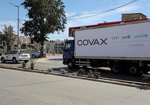 A refrigerated truck loaded with the first delivery of coronavirus vaccine via the United Nations Covax program supporting poorer areas, drives toward the West Bank city of Ramallah, on March 17, 2021