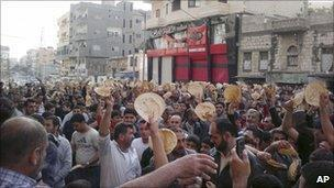 Syrians protest the Assad Regime in Daraa in 2011