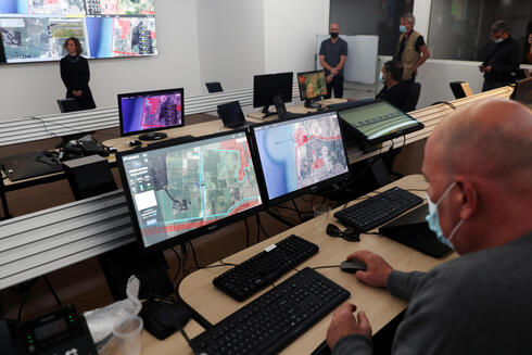 A man works on a computer at an autonomous control centre during a demonstration whereby delivery drones from various companies flew in a joint airspace near Hadera and were managed by the centre in Haifa