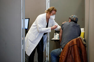 Health worker administers COVID-19 vaccine in Paris, France