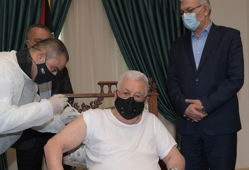 Palestinian Authority President Mahmoud Abbas receives his first shot of COVID-19 vaccine