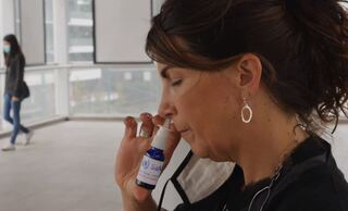 SaNOtize CEO Dr. Gilly Regev displays the company's nasal spray treatment for COVID-19