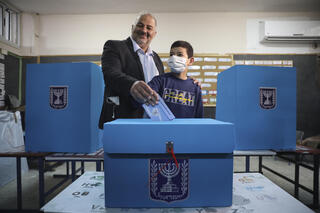 Ra'am leader Mansour Abbas voting in the northern village of Maghar on Election Day
