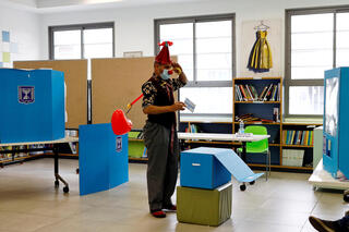 A man dressed as a clown casts his vote in Tel Aviv