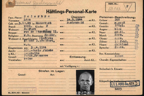 This reproduction handed out on March 22, 2021 by the Arolsen Archives shows the prisoner card (Haeftlings-Personal-Karte) of Frenchman Leon Delarbre who was kept imprisoned by the Nazis in the Auschwitz and Buchenwald concentration camps