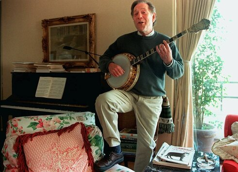 George Segal plays the banjo at his home in Los Angeles, Feb. 1997