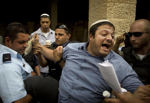 Itamar Ben Gvir in 2010 detained by police after shouting slogans at White House Chief of Staff Rahm Emanuel during his visit to Jerusalem