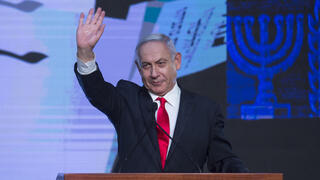 Prime Minister Benjamin Netanyahu speaking to his supporters after exit polls fail to give him clear win in elections