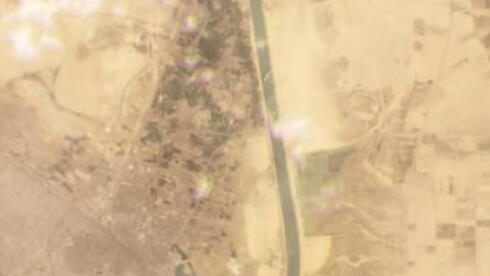 satellite image from Planet Labs Inc. shows the cargo ship MV Ever Given stuck in the Suez Canal