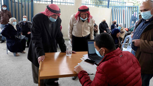 Palestinians register to get their shot of the Covid-19 coronavirus vaccine in the West Bank city of Nablus