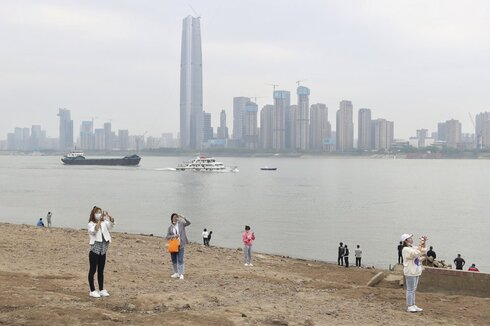 Residents visit the Yangtze River in Wuhan in central China's Hubei province