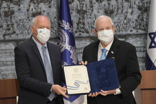 Central Elections Committee Chairman and Supreme Court Justice Uzi Vogelman, left, presents President Reuven (Ruvi) Rivlin with the official results of the March 23 elections to the 24th Knesset, March 31, 2021