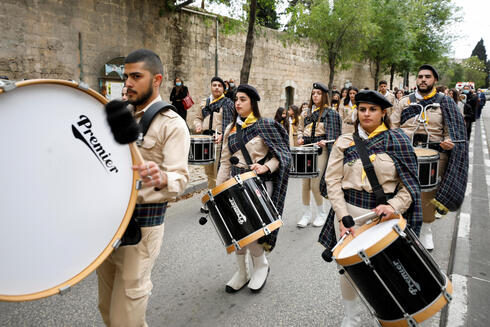 Scouts take part in a Christian procession on the eve of the Feast of the Annunciation in Nazareth, northern Israel