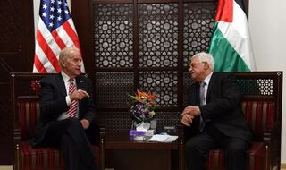 US Vice President Joe Biden (R) and Palestinian president Mahmud Abbas talk during a meeting at the presidential compound in the city of Ramallah, in the West Bank