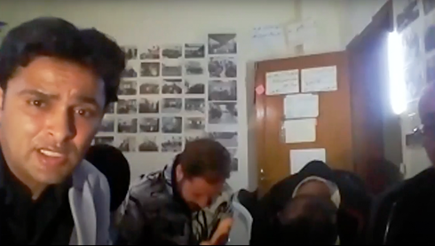 A screengrab from the Zoom video meeting shows Rami Aman, left, one of the organizers of the event, who was later arrested by Hamas