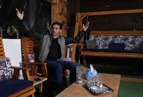Rami Aman, a Palestinian Gazan peace activist, recalls his ordeal, during an interview on the roof of his family house in Gaza City