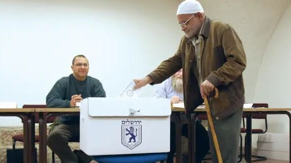 An Arab resident of Jerusalem votes in the city's last municipal elections