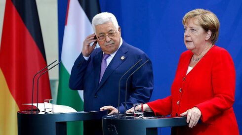 Palestinian President Mahmoud Abbas and German Chancellor Angela Merkel speaking following their meeting in Berlin in 2019